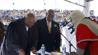"Newly appointed Lesotho prime Minister Thomas Thabane (L), leader of the All Basotho Convention (ABC) political party, is sworn in on June 16, 2017 in Maseru. Lesotho""s new prime minister took office at the head of a coalition government, three years after he was targeted by a putsch and two days after the murder of his estranged wife"