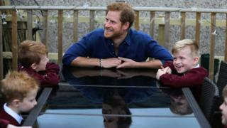"""Prince Harry during a visit to Oliver Rooney""""s home in Bramley"""