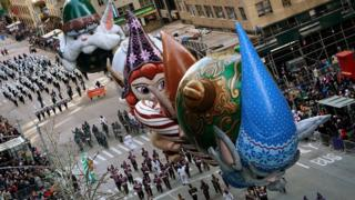 Floats from the film The Christmas Chronicles are carried down the 6th Avenue during the 92nd Macy's Thanksgiving Day Parade in New York City, 22 November 2018