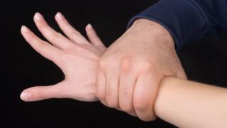 Hand holding arm