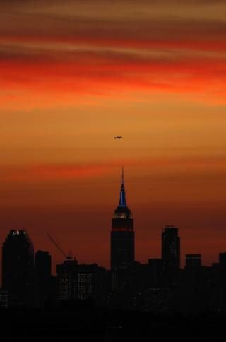 The New York skyline is seen from the US Open tennis tournament after sunset.