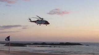 Coastguard helicopter over Rhosneigr Beach