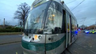 Nottingham tram derails in van crash