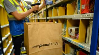 A picture taken on June 9, 2016 shows Amazon warehouse in Paris, part of the new service 'Prime Now'