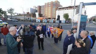 Campaigner Billy Dixon (centre) addressed protestors near the bridge on Tuesday evening