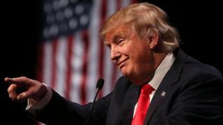 US President Donald Trump dey carry finger point