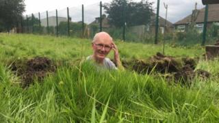 John Edwards in the grave