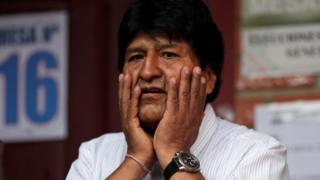 Bolivia's President Evo Morales gestures after casting his vote