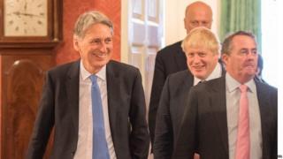 Philip Hammond, Boris Johnson and Liam Fox in Downing Street