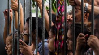 Relatives wait for information at Vidal Pessoa Public Jail, on January 8, 2017, in Manaus, Amazonas, Brazil