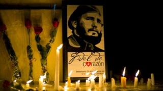 Candles and flowers around a picture of Fidel Castro in Havana. Photo: 26 November 2016