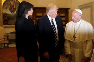 Pope Francis talks with US President Donald Trump and his wife Melania during a private audience at the Vatican