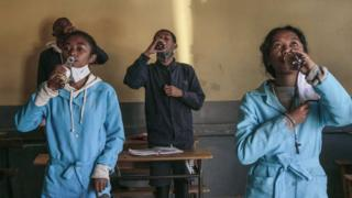 Students in Madagascar drinking the Covid-Organics herbal tonic - April 2020