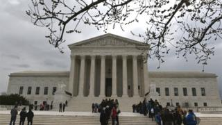 People wait in line outside the U.S. Supreme Court to hear the orders being issued, in Washington