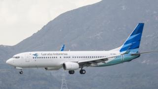 A Boeing 737-8U3 passenger plane belonging to the Garuda Indonesia lands at Hong Kong International Airport in 2018