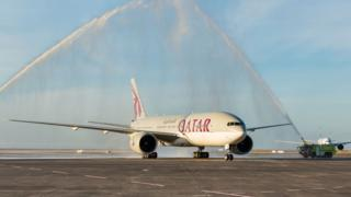 Qatar's Boeing 777-200LR is welcomed with water cannon shower on Monday in Auckland