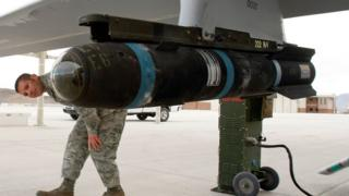 An inert Hellfire missile is loaded on to an MQ-1B Predator drone at Creech Air Force Base, Indian Springs, Nevada. 16 April 2009