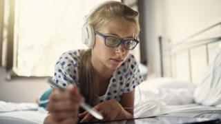 Young girl wearing headphones
