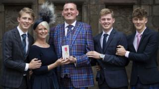 Doddie with his family after receiving his OBE