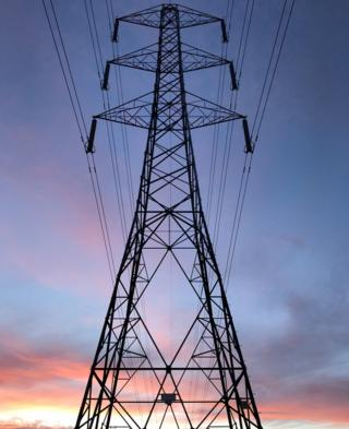 An electricity pylon at sunset