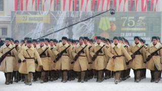 Soldiers dressed in Soviet WW2 uniforms march in St Petersburg. Photo: 27 January 2019