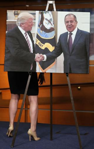 House Democrats display a photograph of President Donald Trump welcoming Russian Foreign Minister Sergey Lavrov to the White House during a news conference at the US Capitol in Washington DC on 17 May 2017.