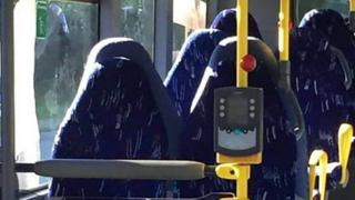 Photo of bus seats which some people are assuming look like women in Burqas
