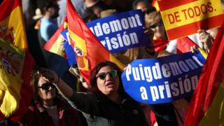 Pro-unity demonstrators with banners calling for the imprisonment of sacked Catalan President Carles Puigdemont, gather in Madrid, Spain, October 28, 2017