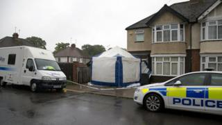 police forensics tent and cordon