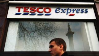 Man walks past Tesco Express