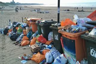 Rubbish piled up beside bins on Longsands beach, Tynemouth