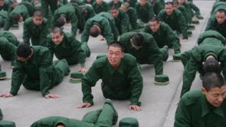 New recruits do pushups at a training base in Chongqing