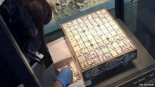 Curator installing the shogi set