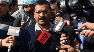 Delhi chief minister Arvind Kejriwal arrives at a polling station in Delhi on February 7, 2015