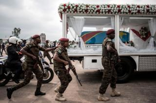 Government forces escort a hearse carrying the coffin of former DR Congo Prime Minister and opposition leader Etienne Tshiseked