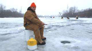 Thomas Darabos, fishing for walleye on the frozen Saginaw River
