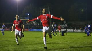 Richie Allen of Salford City celebrates as he scores during the FA Cup first round match