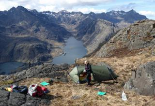 Tent on top of Sgurr na Stri, Skye showing the Black Cuillins ridge and Loch Coruisk