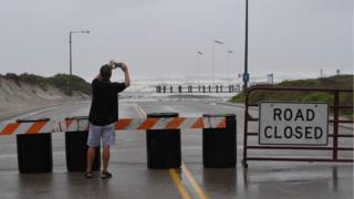 A resident photographs the beach in Corpus Christi