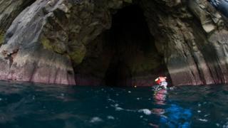 Diver at sea cave