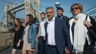 Sadiq Khan with his wife and campaign team near Tower Bridge on the day he became mayor