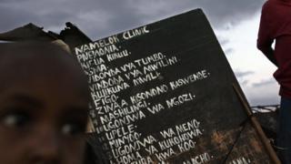 A sign for a herbalist in Kibera slum in Nairobi, Kenya - archive shot