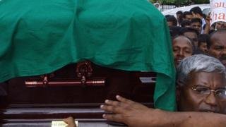 Sri Lankan political and anti-war activists carry the coffin of Tamil legislator Nadarajah Raviraj during a protest march held in Colombo against his assassination, 13 November 2006