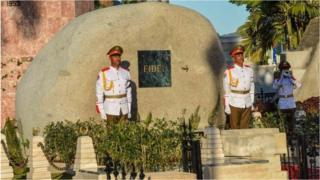 Soldiers stand guard next to a boulder where the ashes of Fidel Castro were placed.