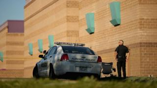 Aurora Police maintains a secure perimeter around the movie theater a day after mass shooting in 2012 in Aurora, Colorado