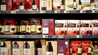 Rows of box wines with bag-in-box packaging in a supermarket