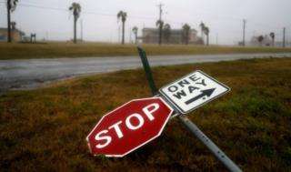 Street signs lie on the ground after winds from Hurricane Harvey escalated in Corpus Christi, Texas, U.S. August 25, 2017.