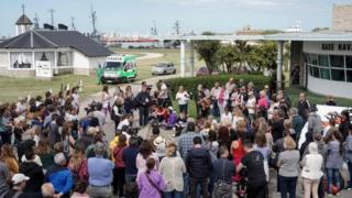 People pray outside Argentina's Navy base in Mar del Plata, on the Atlantic coast south of Buenos Aires, on November 22, 2017, while the search for the missing ARA San Juan submarine keeps going on.