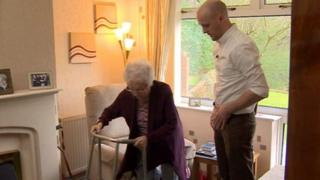An elderly woman being visited in her home by an occupational therapist