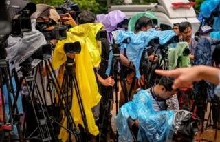 The press waits for an official announcement at Khun Nam Nang Non Forest Park on 30 June